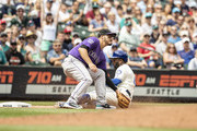 Denard Span #4 of the Seattle Mariners slides safely into third base for a triple before third baseman Nolan Arenado #28 of the Colorado Rockies can make a tag during the fourth inning of a game at Safeco Field on July 8, 2018 in Seattle, Washington.