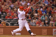Matt Holliday #7 of the St. Louis Cardinals hits a three-run home run in the first inning against the Colorado Rockies at Busch Stadium on September 12, 2014 in St. Louis, Missouri.