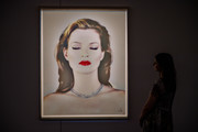 A woman looks at Kate Moss She's Light by Chris Levene during a preview of the Chris Levine: Be Light sale at Sotheby's on September 5, 2019 in London, England. Exhibitions are now open to the public ahead of next weeks Made in Britain, Chris Levine: Be Light and Banksy/Online auctions.