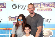 Sarah Shahi (L), Steve Howey (R), Violet Moon Howey, William Wolf Howey, and Knox Blue Howey attend the Columbia Pictures and Sony Pictures Animation's world premiere of 'Hotel Transylvania 3: Summer Vacation' at Regency Village Theatre on June 30, 2018 in Westwood, California.