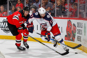 Brandon Dubinsky #17 of the Columbus Blue Jackets battles for the puck during the first period against John Moore #2 of the New Jersey Devils on February 20, 2018 at Prudential Center in Newark, New Jersey.