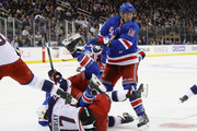 Michael Grabner #40 of the New York Rangers is flipped over Brandon Dubinsky #17 of the Columbus Blue Jackets at Madison Square Garden on November 6, 2017 in New York City. The Rangers defeated the Blue Jackets 5-3.