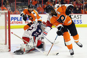 Jakub Voracek #93 and Wayne Simmonds #17 of the Philadelphia Flyers move in on Sergei Bobrovsky #72 of the Columbus Blue Jackets during the second period at the Wells Fargo Center on April 8, 2017 in Philadelphia, Pennsylvania.
