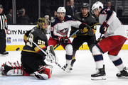(L-R) Marc-Andre Fleury #29 of the Vegas Golden Knights blocks a shot as Oliver Bjorkstrand #28 of the Columbus Blue Jackets, Shea Theodore #27 of the Golden Knights and Josh Anderson #77 of the Blue Jackets watch the puck in the third period of their game at T-Mobile Arena on January 23, 2018 in Las Vegas, Nevada. The Golden Knights won 6-3.