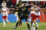 Ethan Finlay #13 of Columbus Crew fights for the ball with Sacha Kljestan #16 of New York Red Bulls during their match at Red Bull Arena on November 29, 2015 in Harrison, New Jersey.
