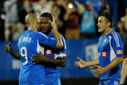 Patrice Bernier #8 of the Montreal Impact celebrates his penalty kick goal with teammate Marco Di Vaio #9 during the match against the Columbus Crew at the Saputo Stadium on July 8, 2012 in Montreal, Quebec, Canada.  The Impact defeated the Crew 2-1.
