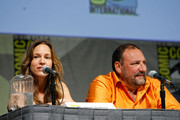"""(L-R) Actors Susan Downey and Joel Silver speak during a panel discussion for """"Sherlock Holmes"""" at Comic-Con 2009 held at San Diego Convention Center on July 24, 2009 in San Diego, California."""