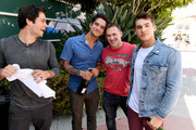 """(L-R) Actors Dylan O'Brien, Tyler Posey, executive producer Jeff Davis, and actor Cody Christian from """"Teen Wolf"""" celebrate their final season backstage after their Hall H panel during Comic-Con International 2017 at San Diego Convention Center on July 20, 2017 in San Diego, California."""