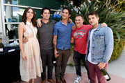 """(L-R) Actors Shelley Hennig, Dylan O'Brien, Tyler Posey, executive producer Jeff Davis, and actor Cody Christian from """"Teen Wolf"""" celebrate their final season backstage after their Hall H panel during Comic-Con International 2017 at San Diego Convention Center on July 20, 2017 in San Diego, California."""
