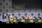 "(L-R) Bill Burr, Vince Gilligan, Peter Gould, Bob Odenkirk, Rhea Seehorn, Patrick Fabian, Michael Mando, and Giancarlo Esposito speak onstage during the ""Breaking Bad"" 10th Anniversary Celebration during Comic-Con International 2018 at San Diego Convention Center on July 19, 2018 in San Diego, California."