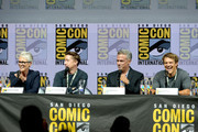 """(L-R) Jamie Lee Curtis, David Gordon Green, Malek Akkad, and Jason Blum speak onstage at Universal Pictures' """"Glass"""" and """"Halloween"""" panels during Comic-Con International 2018 at San Diego Convention Center on July 20, 2018 in San Diego, California."""