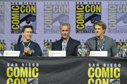 """(L-R) David Gordon Green, Malek Akkad and Jason Blum speak onstage at Universal Pictures' """"Glass"""" and """"Halloween"""" panels during Comic-Con International 2018 at San Diego Convention Center on July 20, 2018 in San Diego, California."""