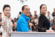 """Actress Huiwen Zhang, director Yimou Zhang and actress Gong Li attend the """"Coming Home"""" photocall at the 67th Annual Cannes Film Festival on May 20, 2014 in Cannes, France."""