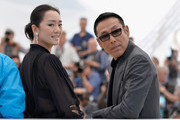 """Actress Gong Li and actor Daoming Chen attend the """"Coming Home"""" photocall at the 67th Annual Cannes Film Festival on May 20, 2014 in Cannes, France."""