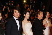 "(l-R) Zhang Huiwen and Zhang Yimou attend the ""Gui Lai"" premiere during the 67th Annual Cannes Film Festival on May 20, 2014 in Cannes, France."