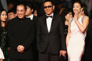 "Zhang Yimou,  Chen Daoming and Gong Li attend the ""Gui Lai"" premiere during the 67th Annual Cannes Film Festival on May 20, 2014 in Cannes, France."