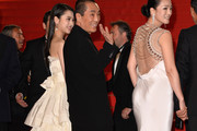 "Zhang Yimou, Zhang Yimou and Gong Li attend the ""Gui Lai"" premiere during the 67th Annual Cannes Film Festival on May 20, 2014 in Cannes, France."