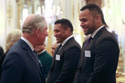 Prince Charles, Prince of Wales meets rugby players Mako (2nd right) and Billy Vunipola at a reception to celebrate the Commonwealth Diaspora community, in the lead up to the Commonwealth Heads of Government meeting in London this April, at Buckingham Palace on February 14, 2018 in London, England.
