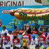 Joey Chestnut Photos - Joey Chestnut (C) competes in the annual Nathan's Hot Dog Eating Contest on July 4, 2018 in the Coney Island neighborhood of the Brooklyn borough of New York City. Chestnut won the contest, setting a Coney Island record, eating 74 hot dogs in 10 minutes. - Competitive Eaters Gorge At Annual Nathan's Hot Dog Eating Contest