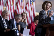 Vice President Joseph Biden, Senate Majority Leader Harry Reid (D-NV) and Caroline Kennedy listen while House Minority Leader Nancy Pelosi (D-CA) speaks during an event to honor John F. Kennedy's inauguration on Capitol Hill January 20, 2011 in Washington, DC.  John F. Kennedy, a former Senator and the 35th President of the United States, delivered his first inaugural address 50 years ago today.
