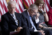 Vice President Joseph Biden, Senate Majority Leader Harry Reid (D-NV) and Caroline Kennedy listen to a recording of John F. Kennedy's inauguration speech during an event to honor his inauguration on Capitol Hill January 20, 2011 in Washington, DC.  John F. Kennedy, a former Senator and the 35th President of the United States, delivered his first inaugural address 50 years ago today.