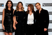 """(L-R) Actress Minnie Driver, actress Hilary Swank, subject of film Betty Anne Waters and actor Sam Rockwell pose at the """"Conviction"""" photocall during the 54th BFI London Film Festival at the Vue West End on October 15, 2010 in London, England."""