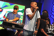Hip-hop artists Chad Hugo and Pharrell Williams of N.E.R.D. perform during the Coors Light Search for the Coldest National competition and tour at Highline Ballroom on May 31, 2011 in New York, New York.