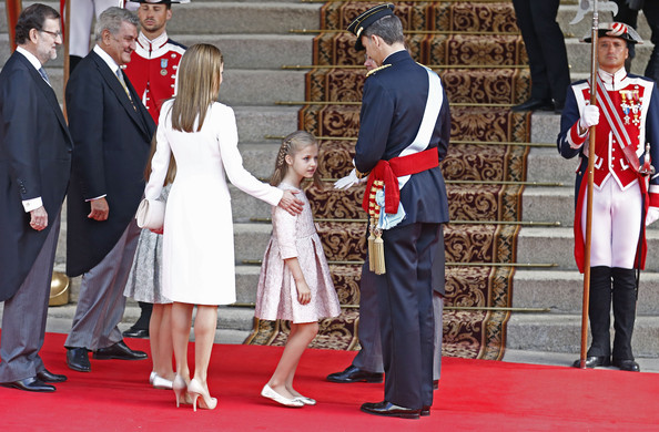 Princess Leonor,  Princess of Asturias stands between King Felipe VI of Spain and Queen Letizia of Spain as they arrive at the Lions Gate, the Congress of Deputies during the King's official coronation ceremony on June 19, 2014 in Madrid, Spain. The coronation of King Felipe VI is held in Madrid. His father, the former King Juan Carlos of Spain abdicated on June 2nd after a 39 year reign. The new King is joined by his wife Queen Letizia of Spain.