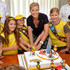 Sophie, Countess of Wessex with her daughter Lady Louise Windsor (2nd right) cut a giant birthday cake as she hosts a tea party  at Buckingham Palace, London, to mark the 100th anniversary of the Brownies on June 25, 2014 in London, England.