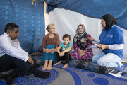 Sophie, Countess of Wessex (2nd L) and Tariq Ahmad, Baron Ahmad of Wimbledon (L) talk to Asmaa (2nd R) aged 25, and her daughter Sidra, aged 6, through an interpreter (R), on a visit to an informal tented settlement, during the first official Royal visit to the country, on June 12, 2019 in Bekaa Valley, Lebanon. The Countess of Wessex announced her commitment to supporting the UK's efforts in the Women, Peace and Security agenda (WPS), and the Preventing Sexual Violence in Conflict Initiative (PSVI) earlier this year.