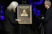 Ricky Skaggs (L) is presented with his Hall of Fame plaque from CMHOF's Kyle Young during the 2018 Country Music Hall of Fame and Museum Medallion Ceremony honoring inductees Johnny Gimble, Ricky Skaggs and Dottie West at Country Music Hall of Fame and Museum on October 21, 2018 in Nashville, Tennessee.