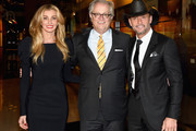 Faith Hill, Country Music Hall of Fame and Museum CEO Kyle Young, and Tim McGraw attend the Country Music Hall of Fame and Museum's debut of the Tim McGraw and Faith Hill Exhibition on November 15, 2017 in Nashville, Tennessee.