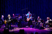 "Singer/Songwriter Deana Carter (2nd from left) joins Nashville Cats members David Briggs (piano), Norbert Putnam (Bass), Charlie McCoy (Harmonica/band leader) Musicians Wanda Vick (banjo/strings), Kenny Malone (drums) along with Nashville Cats members Mac Gayden (guitar),Wayne Moss (guitar) and Lloyd Green (guitar) during Listen To The Band: The Nashville Cats In Concert With Special Guests For ""Dylan, Cash, And The Nashville Cats"" Exhibition Opening Weekend at the Country Music Hall of Fame and Museum on March 28, 2015 in Nashville, Tennessee."