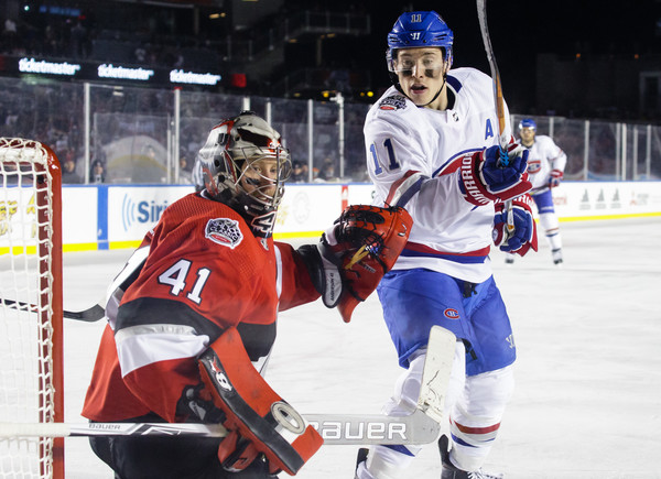 2017 Scotiabank NHL 100 Classic - Montreal Canadiens v Ottawa Senators [player,college ice hockey,ice hockey,sports gear,ice hockey position,sports,hockey protective equipment,ice hockey equipment,hockey pants,sports equipment,craig anderson,brendan gallagher,net,lansdowne park,canada,ottawa,ottawa senators,montreal canadiens,scotiabank,nhl]