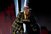 RuPaul (L) and host Loni Love onstage during the Critics' Choice Real TV Awards at The Beverly Hilton Hotel on June 02, 2019 in Beverly Hills, California.