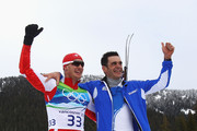 Dario Cologna of Switzerland and Pietro Piller Cottrer of Italy celebrate preliminary gold and silveer respectively in the men's cross-country skiing 15 km final on day 4 of the 2010 Winter Olympics at Whistler Olympic Park Cross-Country Stadium on February 15, 2010 in Whistler, Canada.