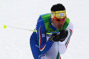 Pietro Piller Cottrer of Italy competes in the men's cross-country skiing 15 km final on day 4 of the 2010 Winter Olympics at Whistler Olympic Park Cross-Country Stadium on February 15, 2010 in Whistler, Canada.