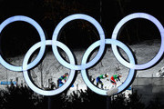 Stina Nilsson of Sweden, Maiken Caspersen Falla of Norway and Jessica Diggins of the United States compete as they pass the Olympic Rings during the Cross Country Ladies' Team Sprint Free Final on day 12 of the PyeongChang 2018 Winter Olympic Games at Alpensia Cross-Country Centre on February 21, 2018 in Pyeongchang-gun, South Korea.