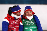 Bbronze medalists Marit Bjoergen and Maiken Caspersen Falla of Norway celebrate on the podium during the victory ceremony for the Cross Country Ladies' Team Sprint Free on day 12 of the PyeongChang 2018 Winter Olympic Games at Alpensia Cross-Country Centre on February 21, 2018 in Pyeongchang-gun, South Korea.