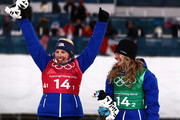 Kikkan Randall of the United States (red bib) and Jessica Diggins of the United States celebrate on the podium during the victory ceremony for the Cross Country Ladies' Team Sprint Free on day 12 of the PyeongChang 2018 Winter Olympic Games at Alpensia Cross-Country Centre on February 21, 2018 in Pyeongchang-gun, South Korea.