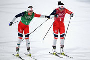 Marit Bjoergen of Norway (1-1) and Maiken Caspersen Falla of Norway handover during the Cross Country Ladies' Team Sprint Free Final on day 12 of the PyeongChang 2018 Winter Olympic Games at Alpensia Cross-Country Centre on February 21, 2018 in Pyeongchang-gun, South Korea.