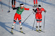 Marit Bjoergen of Norway (R) and Maiken Caspersen Falla of Norway handover during the Cross Country Ladies' Team Sprint Free on day 12 of the PyeongChang 2018 Winter Olympic Games at Alpensia Cross-Country Centre on February 21, 2018 in Pyeongchang-gun, South Korea.