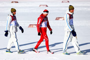 (L-R) Silver medalist Johan Olsson of Sweden, gold medalist Dario Cologna of Switzerland and bronze medalist Daniel Richardsson of Sweden walk to the podium during the flower ceremony for the Cross Country Men's 15km Classic event during day seven of the Sochi 2014 Winter Olympics at Laura Cross-country Ski & Biathlon Center on February 14, 2014 in Sochi, Russia.