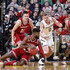 Robert Johnson #4 of the Indiana Hoosiers goes to the floor for a loose ball against Rex Pflueger #0 of the Notre Dame Fighting Irish during the Crossroads Classic at Bankers Life Fieldhouse on December 16, 2017 in Indianapolis, Indiana. Indiana won 80-77 in overtime.