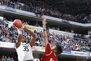 Bonzie Colson #35 of the Notre Dame Fighting Irish shoots the ball against Juwan Morgan #13 and Robert Johnson #4 of the Indiana Hoosiers in the first half of the Crossroads Classic at Bankers Life Fieldhouse on December 16, 2017 in Indianapolis, Indiana.