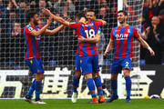 James McArthur of Crystal Palace celebrates with Yohan Cabaye after scoring his sides second goal during the Premier League match between Crystal Palace and Leicester City at Selhurst Park on April 28, 2018 in London, England.