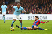 Fernandinho of Manchester City evades Yohan Cabaye of Crystal Palace during the Premier League match between Crystal Palace and Manchester City at Selhurst Park on December 31, 2017 in London, England.