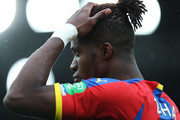 Wilfried Zaha of Crystal Palace looks on prior to the Premier League match between Crystal Palace and Newcastle United at Selhurst Park on September 22, 2018 in London, United Kingdom.
