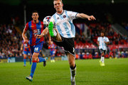Mark Ellis of Shrewsbury Town controls the ball ahead of Martin Kelly of Crystal Palace during the Capital One Cup second round match between Crystal Palace and Shrewsbury Town at Selhurst Park on August 25, 2015 in London, England.
