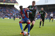 Wilfried Zaha of Crystal Palace is challenged by Marco van Ginkel of Stoke City during The Emirates FA Cup fourth round match between Crystal Palace and Stoke City at Selhurst Park on January 30, 2016 in London, England.